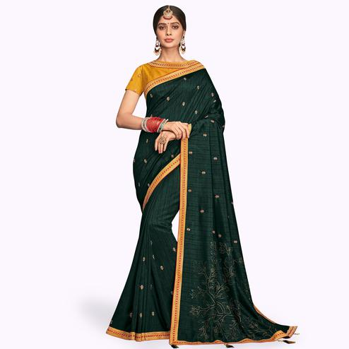 Impressive Dark Green Colored Partywear Embroidered Raw Silk Saree