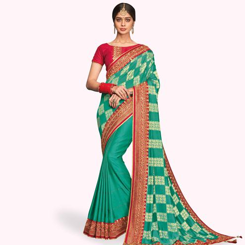Preferable Turquoise Green Colored Partywear Embroidered Raw Silk Half-Half Saree