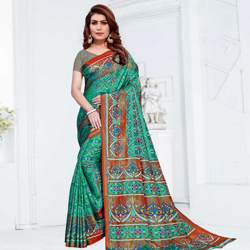 Entrancing Green Colored Casual Printed Patola Printed Art Silk Saree