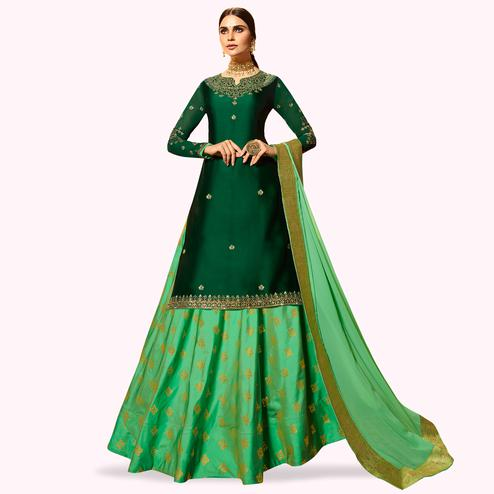 Mesmerising Dark Green Colored Partywear Embroidered Satin Georgette Lehenga Kameez