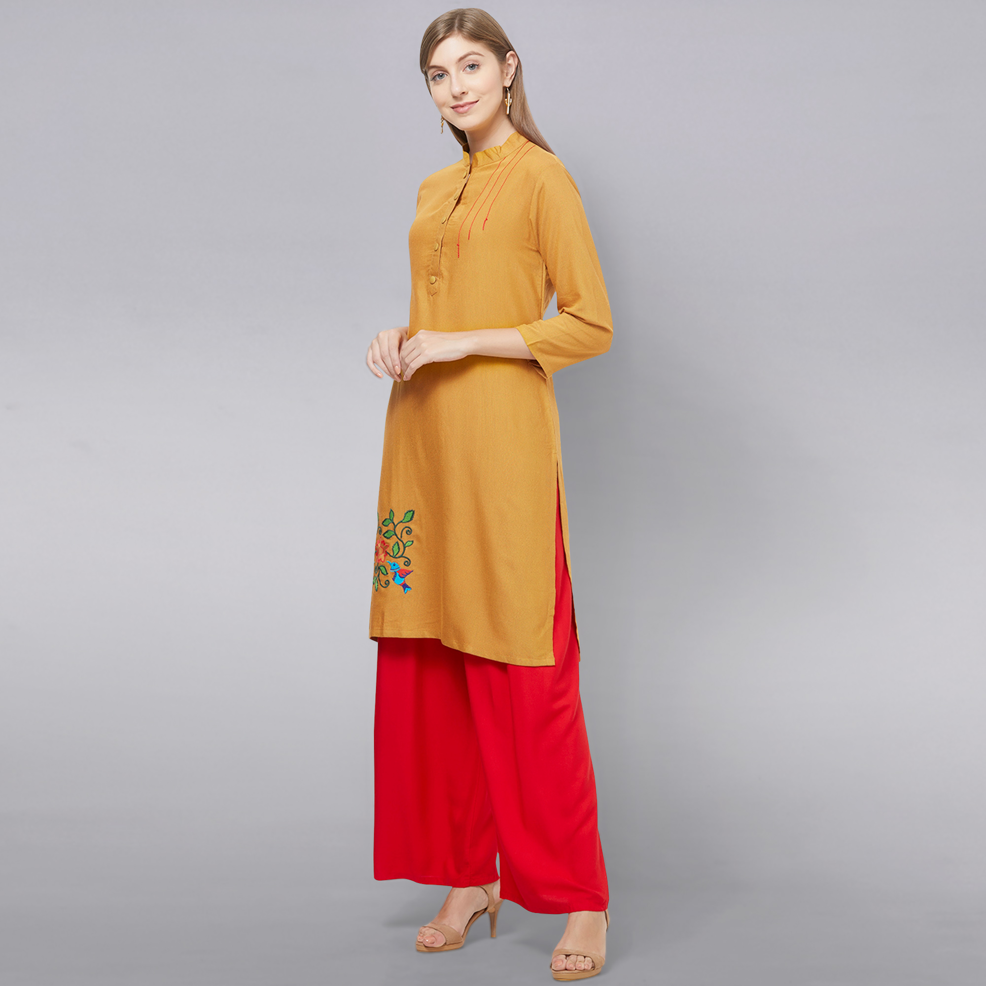 Beautiful Mustard Yellow Colored Casual Embroidered Cotton Kurti