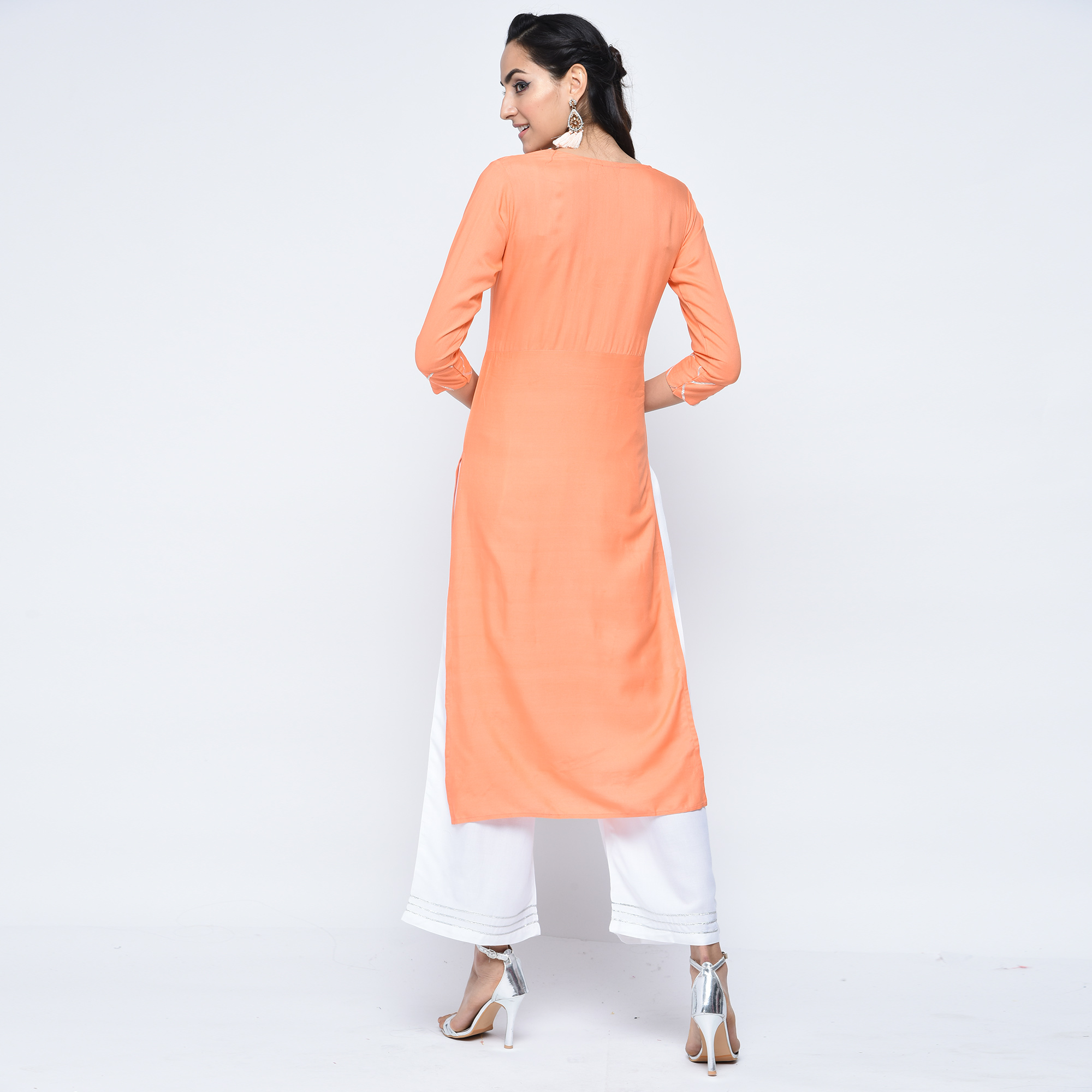 Captivating Light Orange Colored Casual Printed Viscose Palazzo Suit