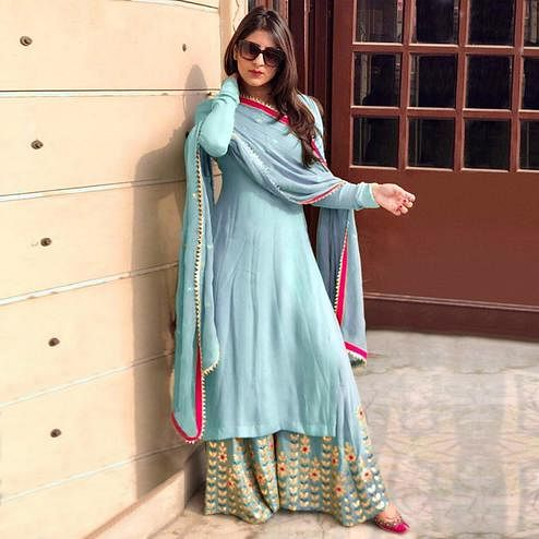 Entrancing Pastel Blue Colored Partywear Embroidered Georgette Palazzo Suit