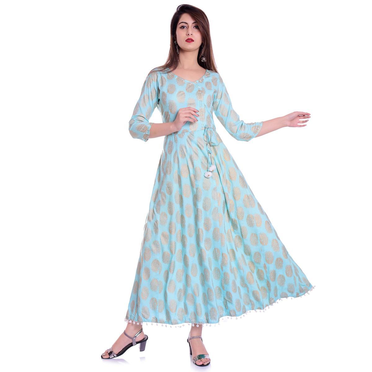 Engrossing Light Turquoise Blue Colored Partywear Printed Rayon Kurti