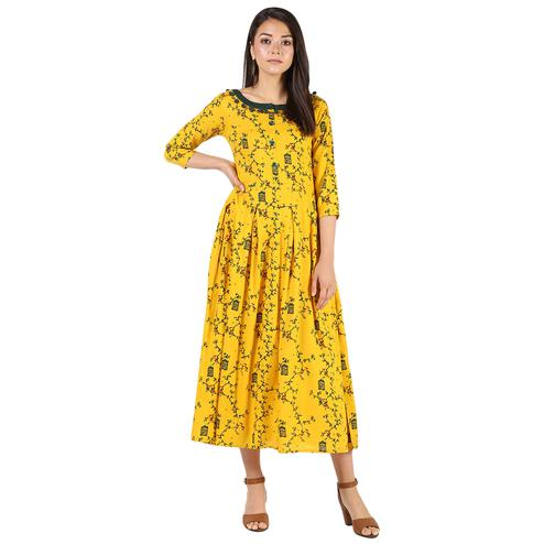 Surpassing Yellow Colored Partywear Printed Rayon Kurti