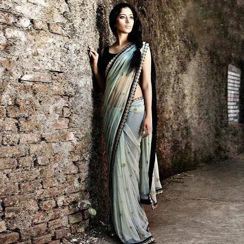 Opulent Light Gray Colored Partywear Embroidered Georgette Saree
