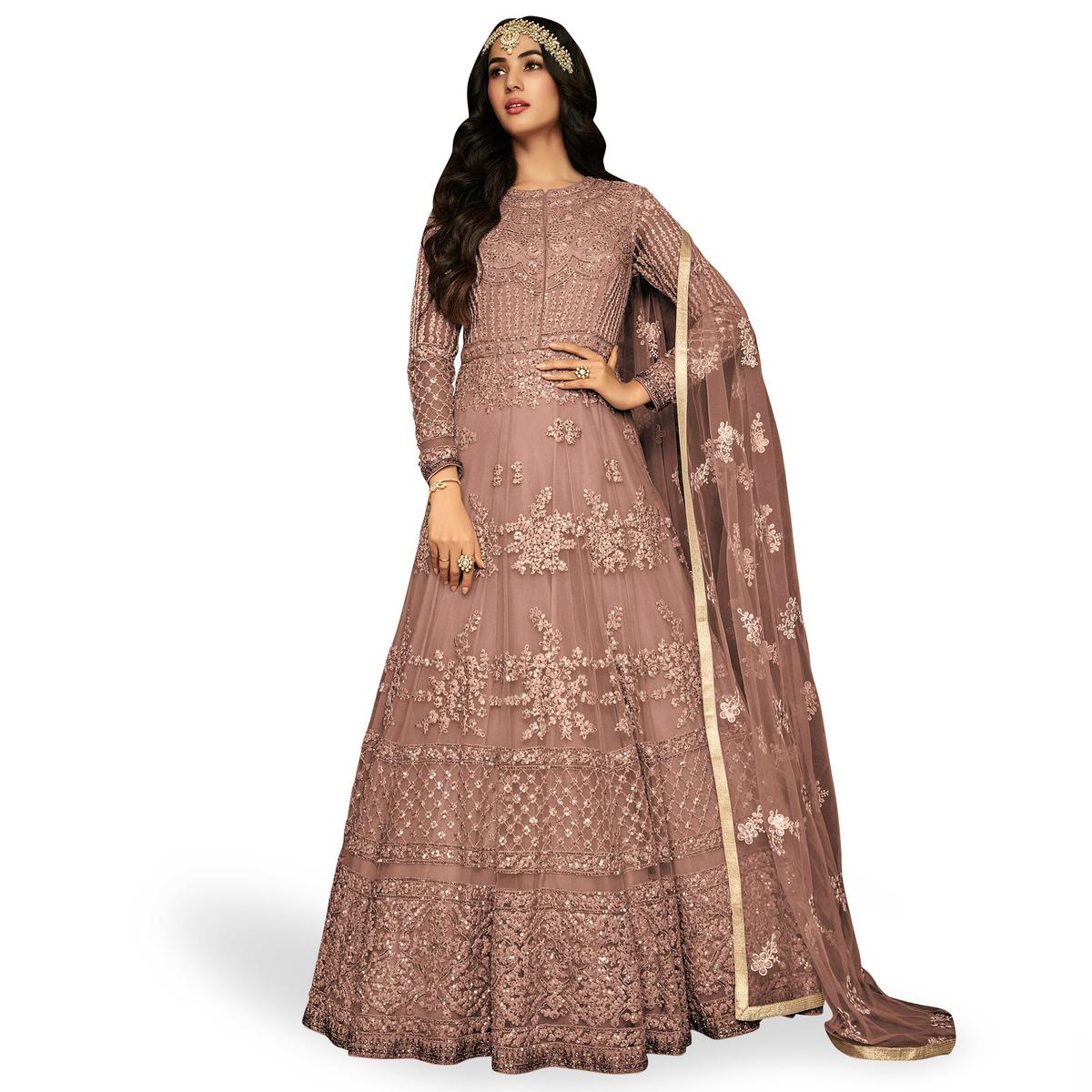 Ravishing Mauve Colored Partywear Embroidered Netted Anarkali Suit
