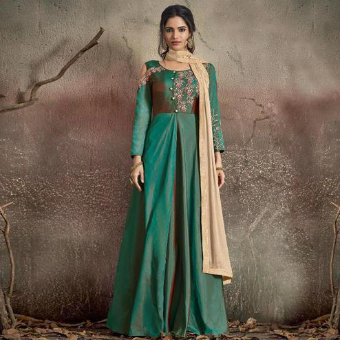 Captivating Turquoise Green Colored Partywear Embroidered Tapeta Silk Gown