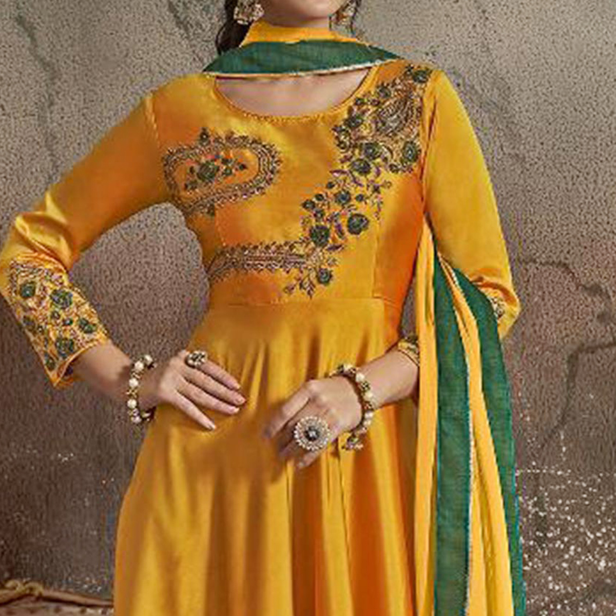 Eye-catching Yellow Colored Partywear Embroidered Tapeta Silk Gown
