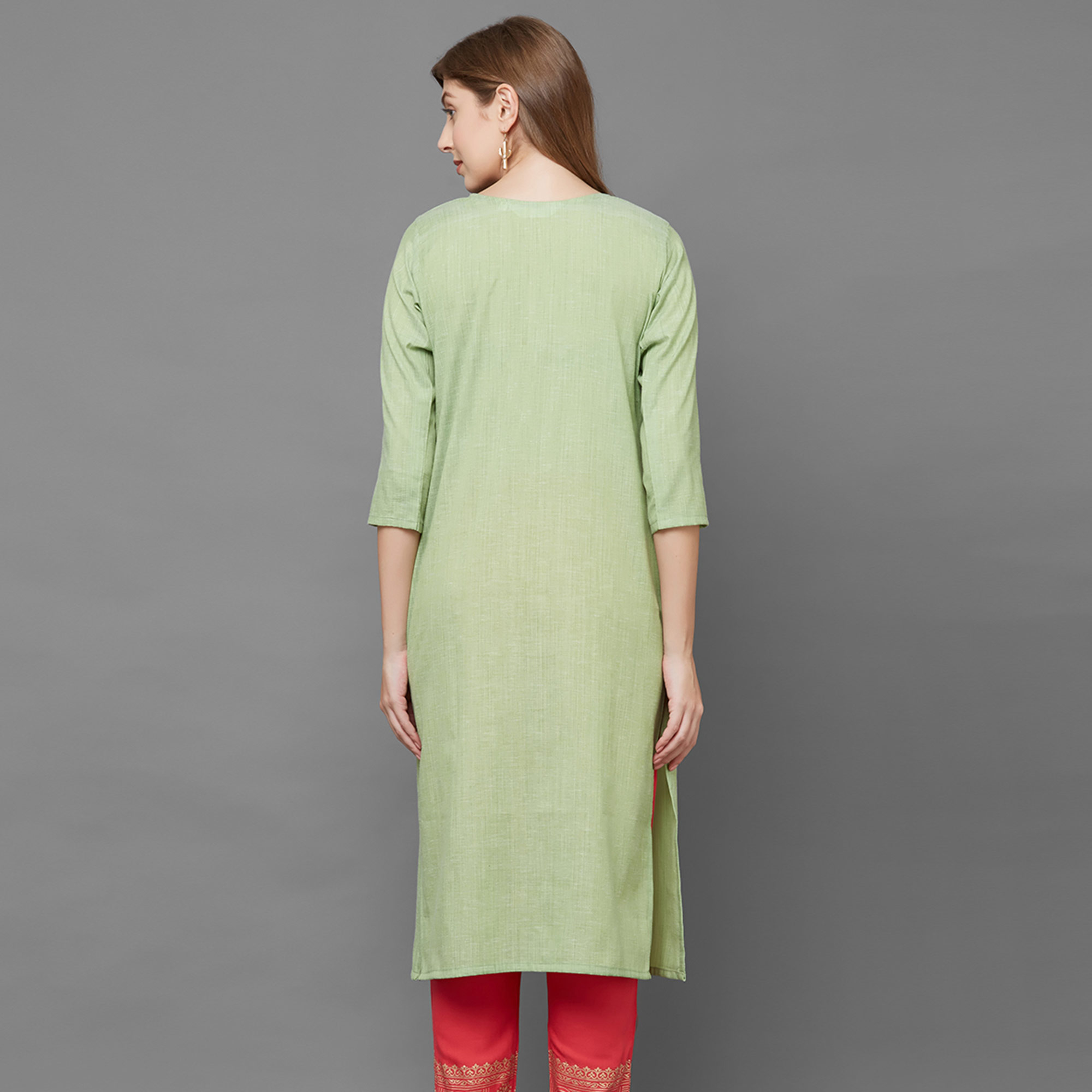 Attractive Green Colored Partywear Embroidered Cotton Kurti