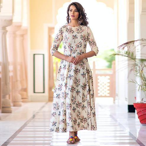 Refreshing Cream Colored Partywear Printed Muslin Blend Long Kurti