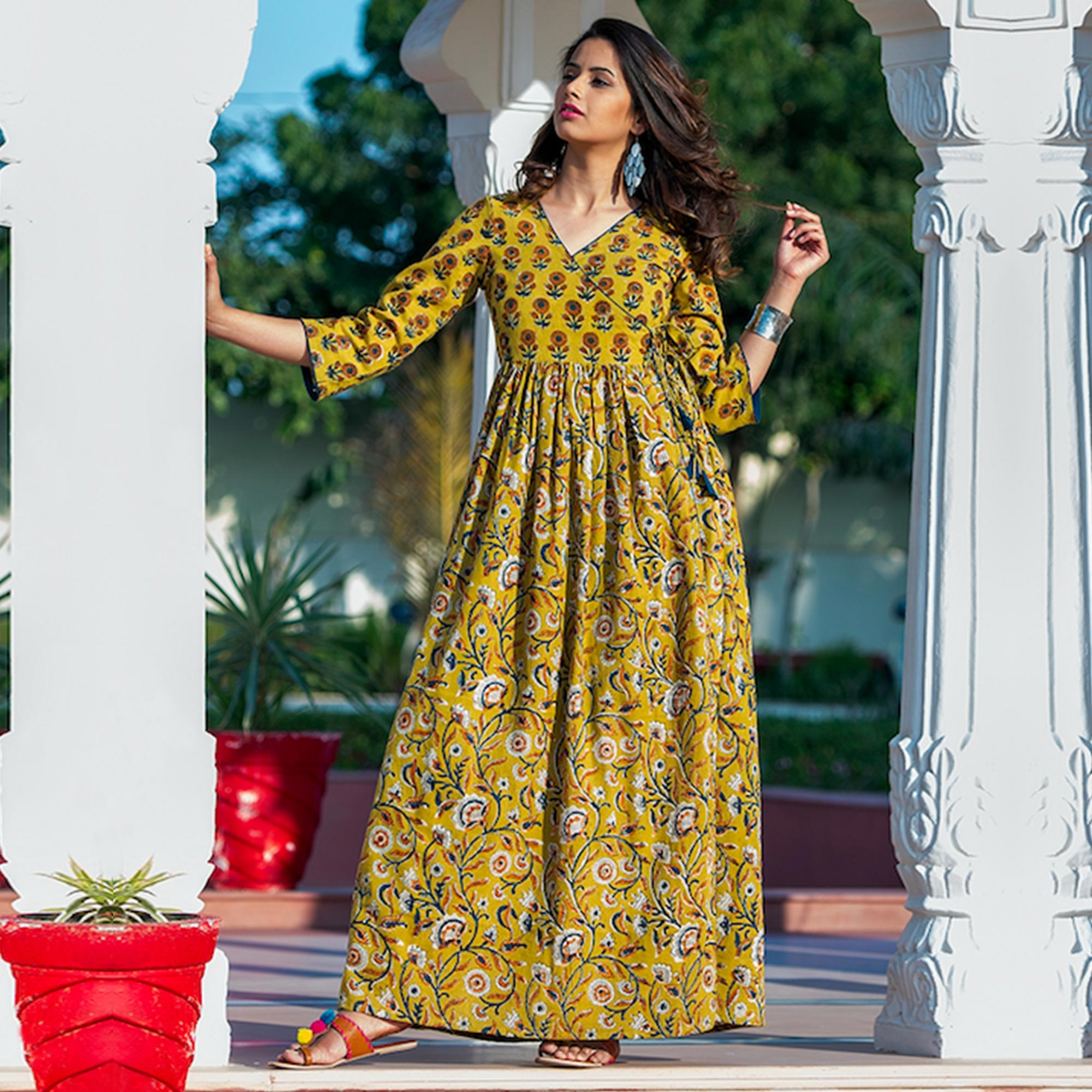 Hypnotic Yellow Colored Partywear Printed Pure Muslin Long Kurti