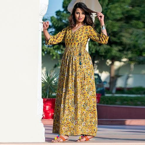 Hypnotic Yellow Colored Partywear Printed Muslin Blend Long Kurti