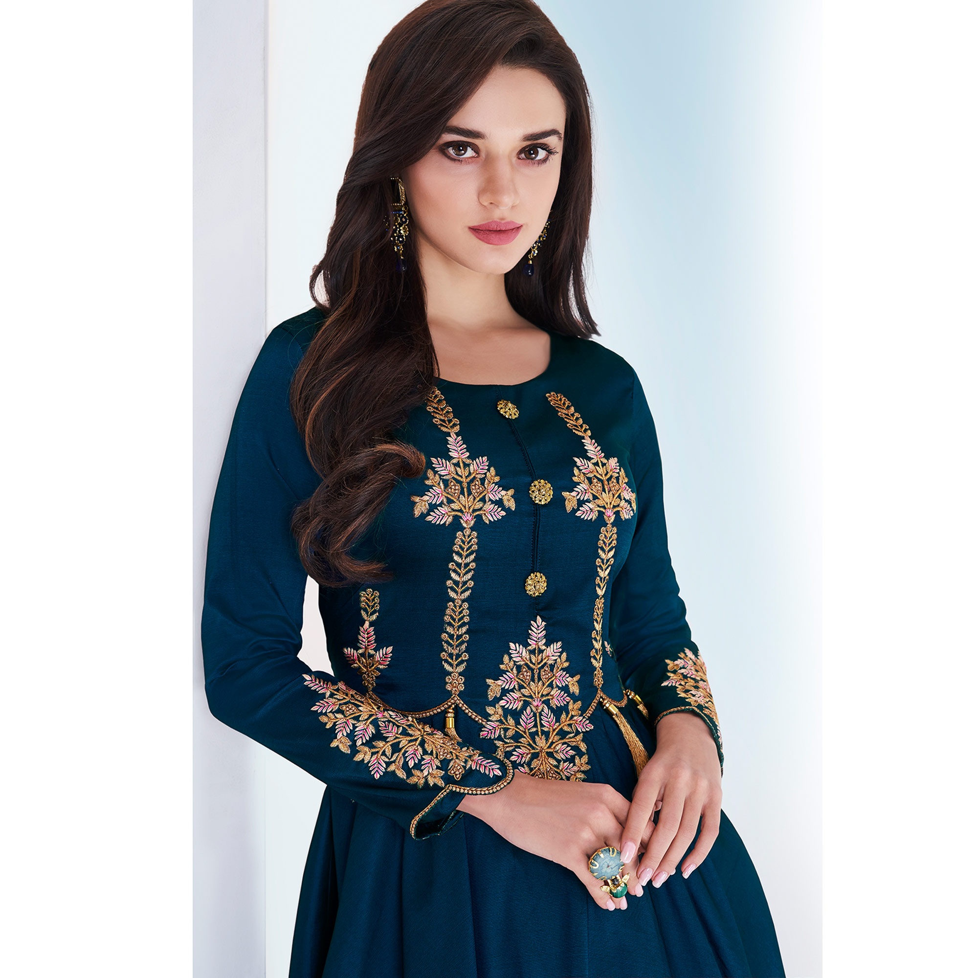 Pleasant Teal Blue Colored Partywear Embroidered Tapetta Satin Gown