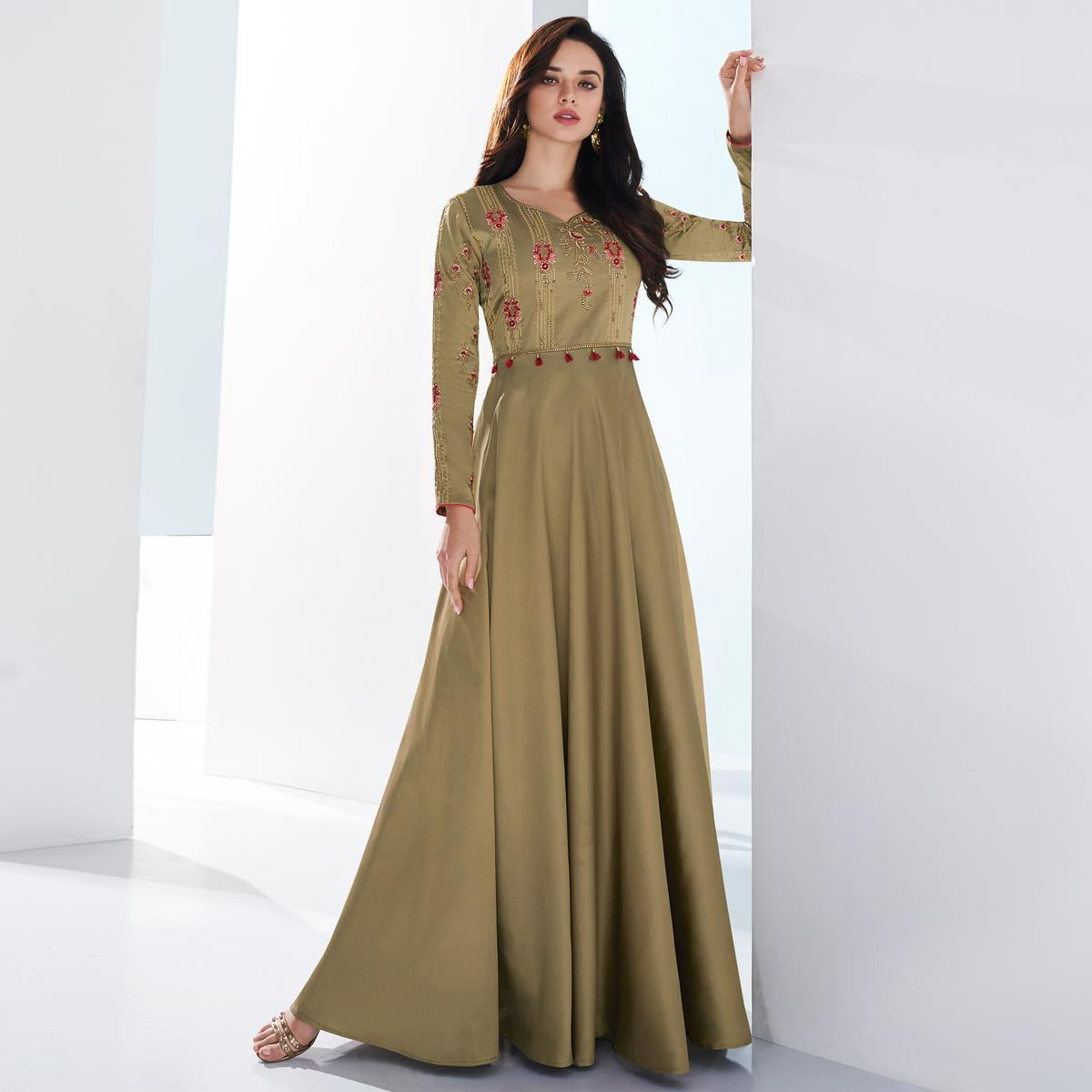 Gleaming Chiku Colored Partywear Embroidered Tapetta Satin Gown
