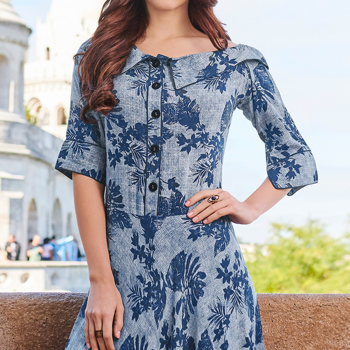Mesmeric Blue Colored Partywear Printed Rayon Kurti