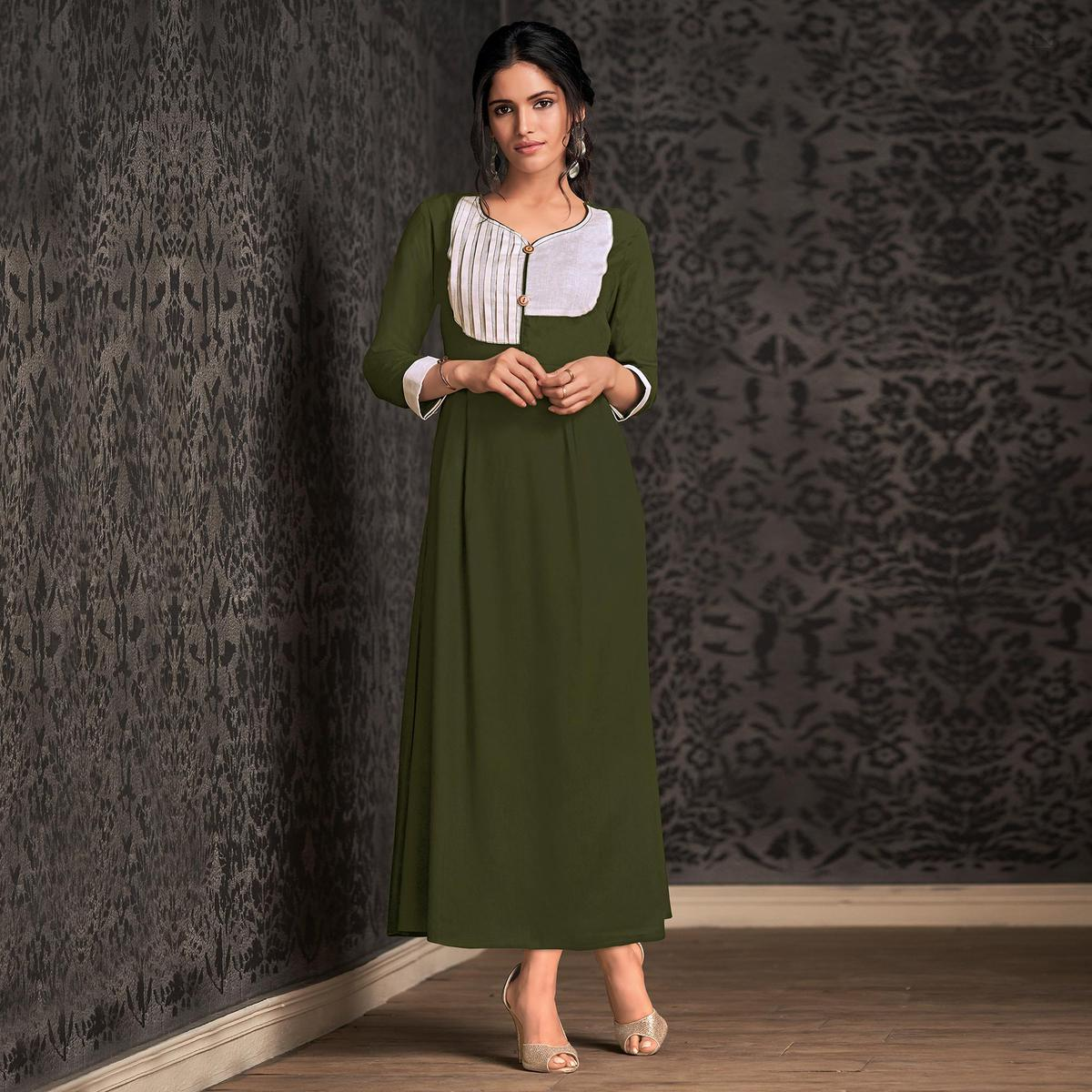 Innovative Green Colored Partywear Embroidered Rayon Long Kurti