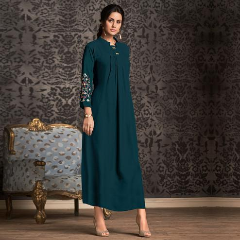 Magnetic Rama Blue Colored Partywear Embroidered Rayon Long Kurti