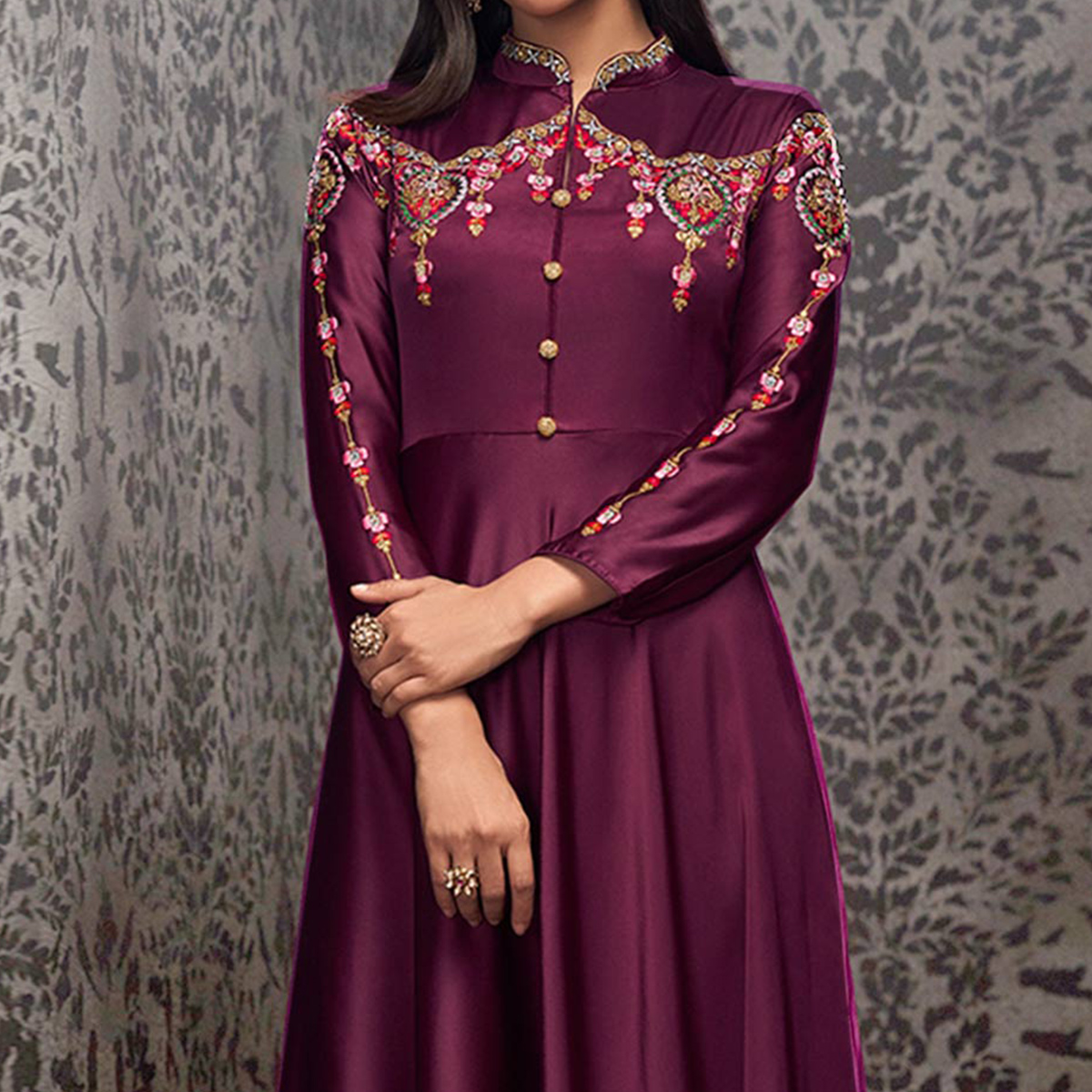 Hypnotic Dark Purple Colored Partywear Embroidered Glowing Georgette Gown
