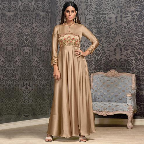 Preferable Beige Colored Partywear Embroidered Glowing Georgette Gown