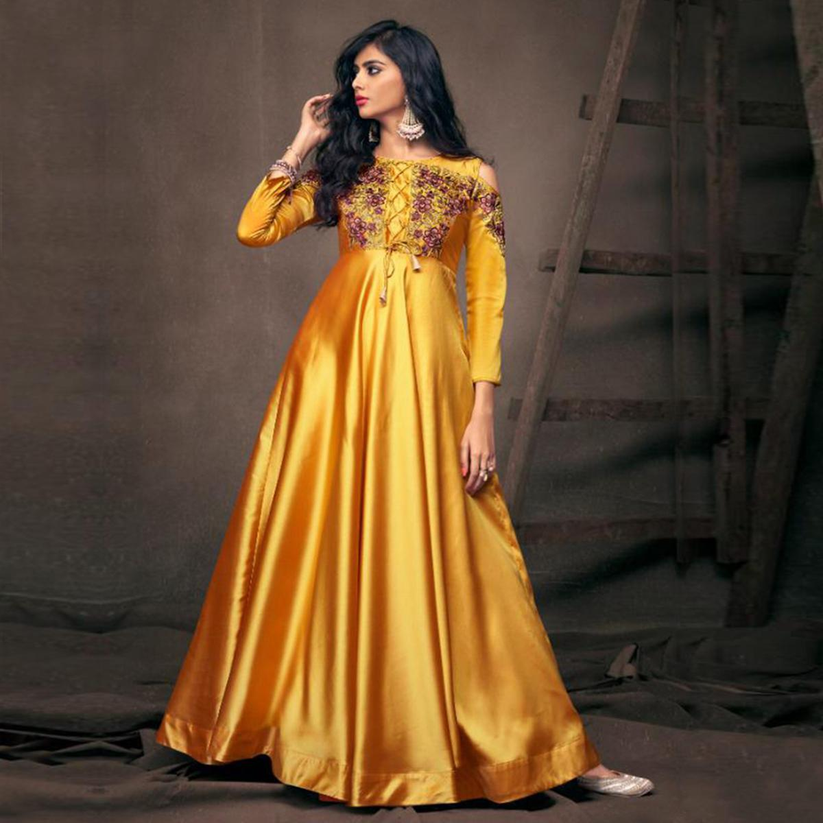Pretty Yellow Colored Partywear Embroidered Tapeta Silk Gown