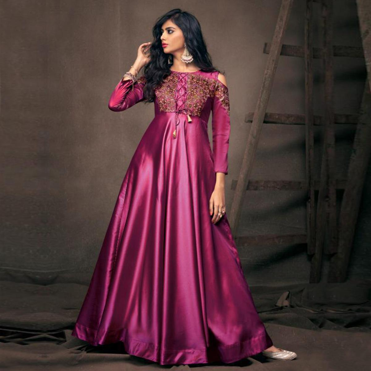 Alluring Magenta Pink Colored Partywear Embroidered Tapeta Silk Gown