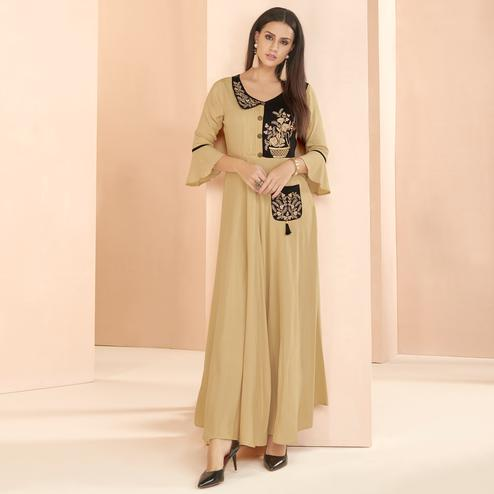 Impressive Beige Colored Partywear Embroidered Heavy Rayon Long Kurti
