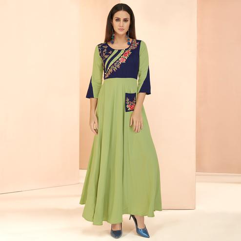 Pleasance Light Green Colored Partywear Embroidered Heavy Rayon Long Kurti