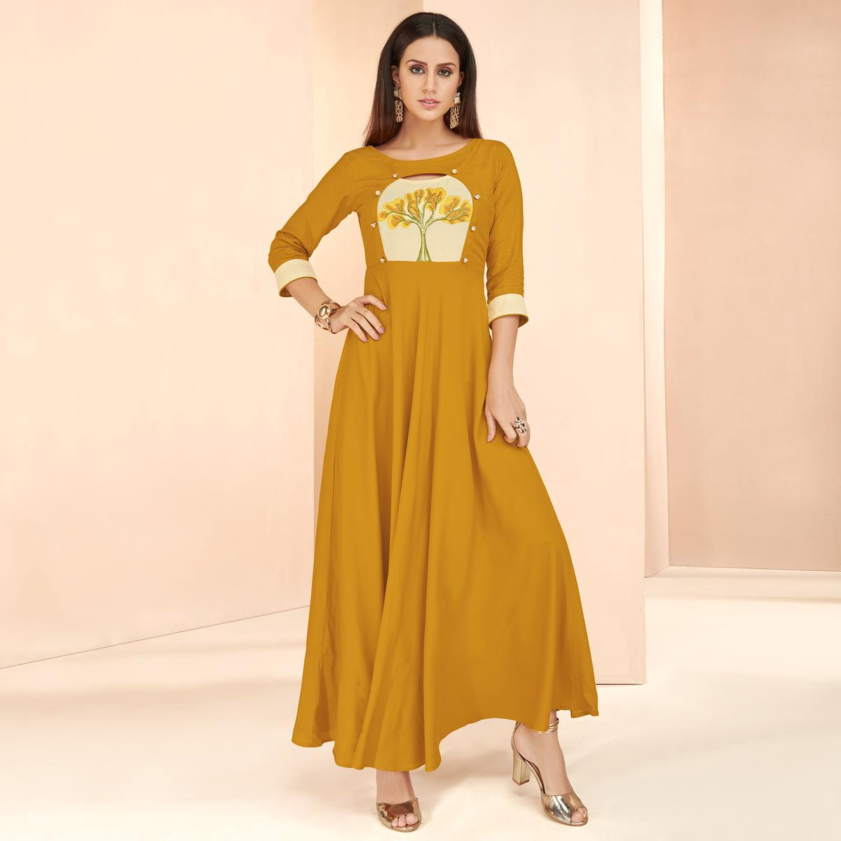 Ethnic Mustard Yellow Colored Partywear Embroidered Heavy Rayon Long Kurti