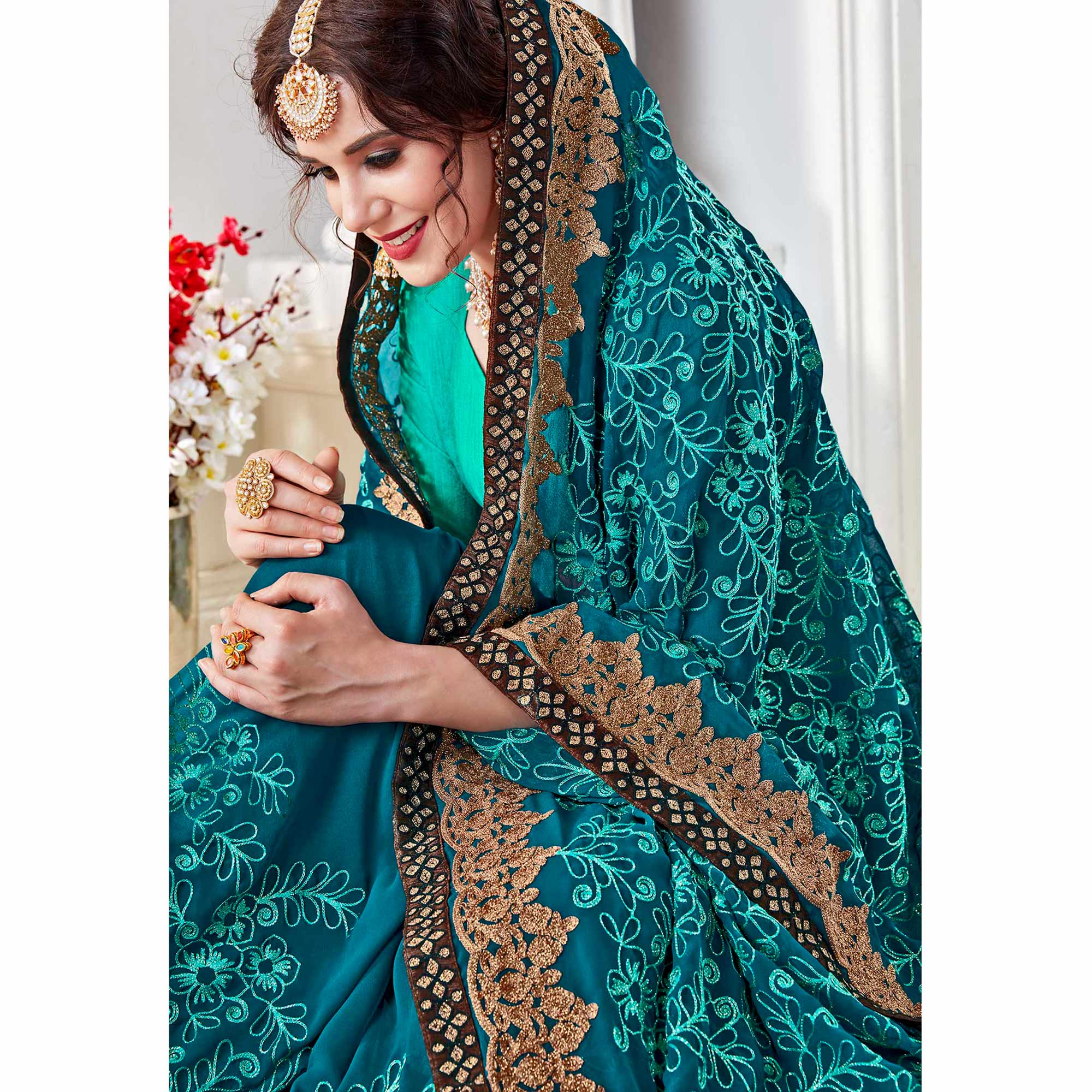 Desirable Rama Blue Colored Partywear Embroidered Georgette Saree