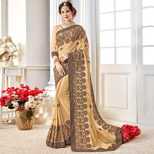Exotic Beige Colored Partywear Embroidered Georgette Saree