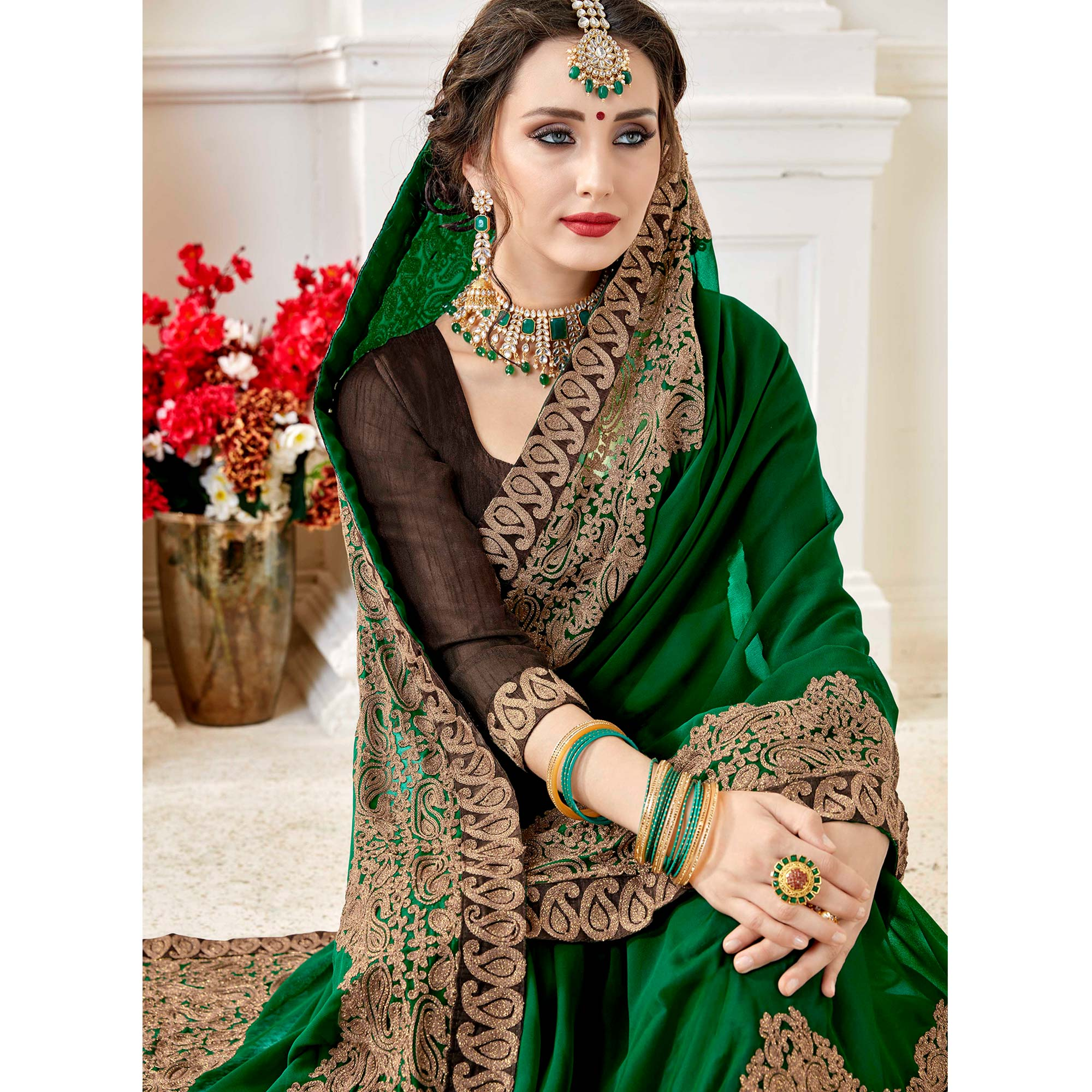 Sophisticated Green Colored Partywear Embroidered Georgette Saree