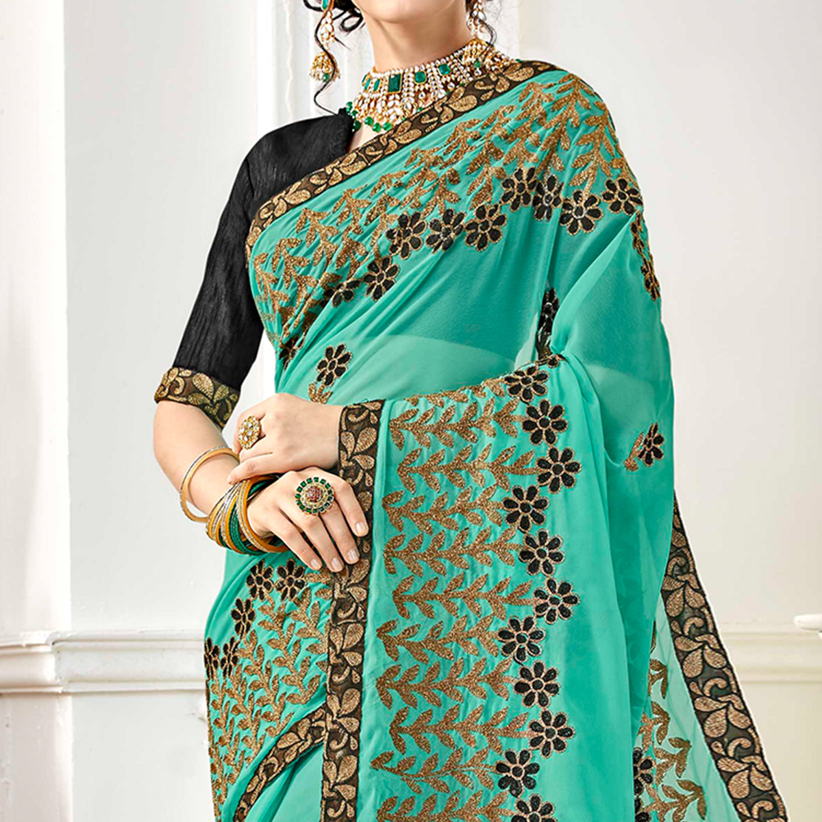 Elegant Turquoise Green Colored Partywear Embroidered Georgette Saree