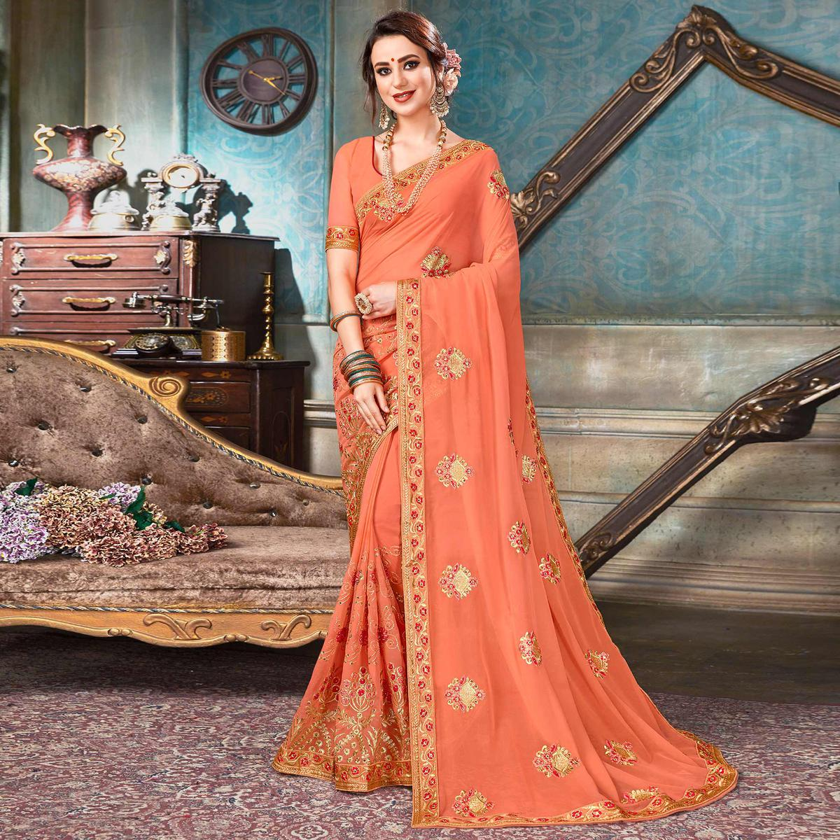 Glowing Peach Colored Partywear Embroidered Georgette Saree