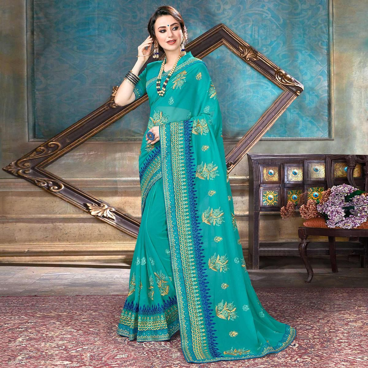 Mesmeric Sky Blue Colored Partywear Embroidered Georgette Saree