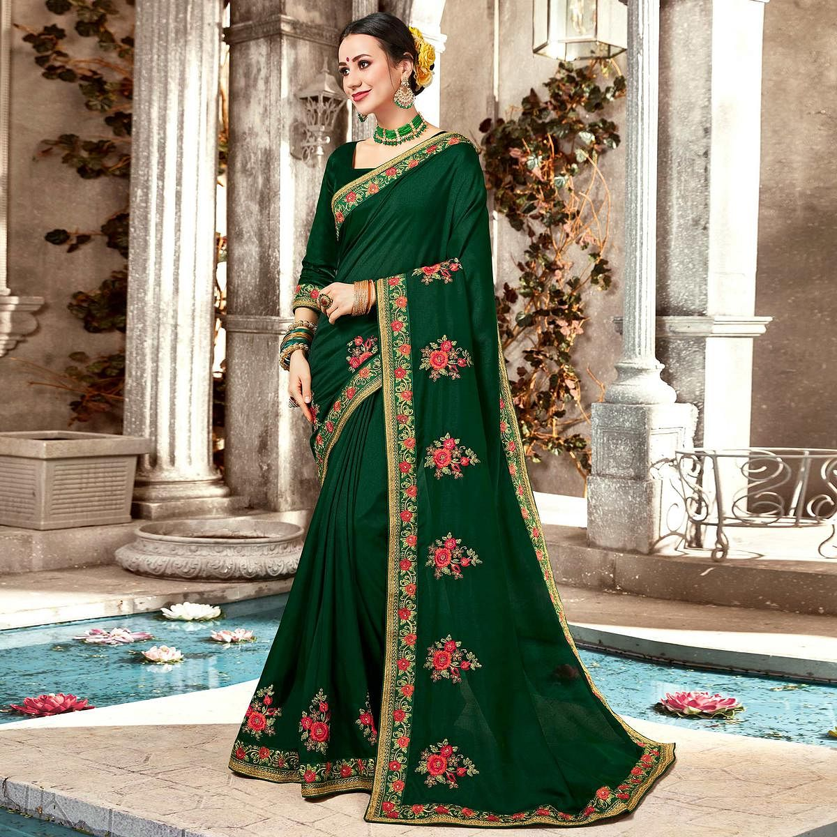 Magnetic Dark Green Colored Partywear Embroidered Georgette Saree