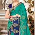 Flattering Turquoise Green Colored Partywear Embroidered Georgette Saree