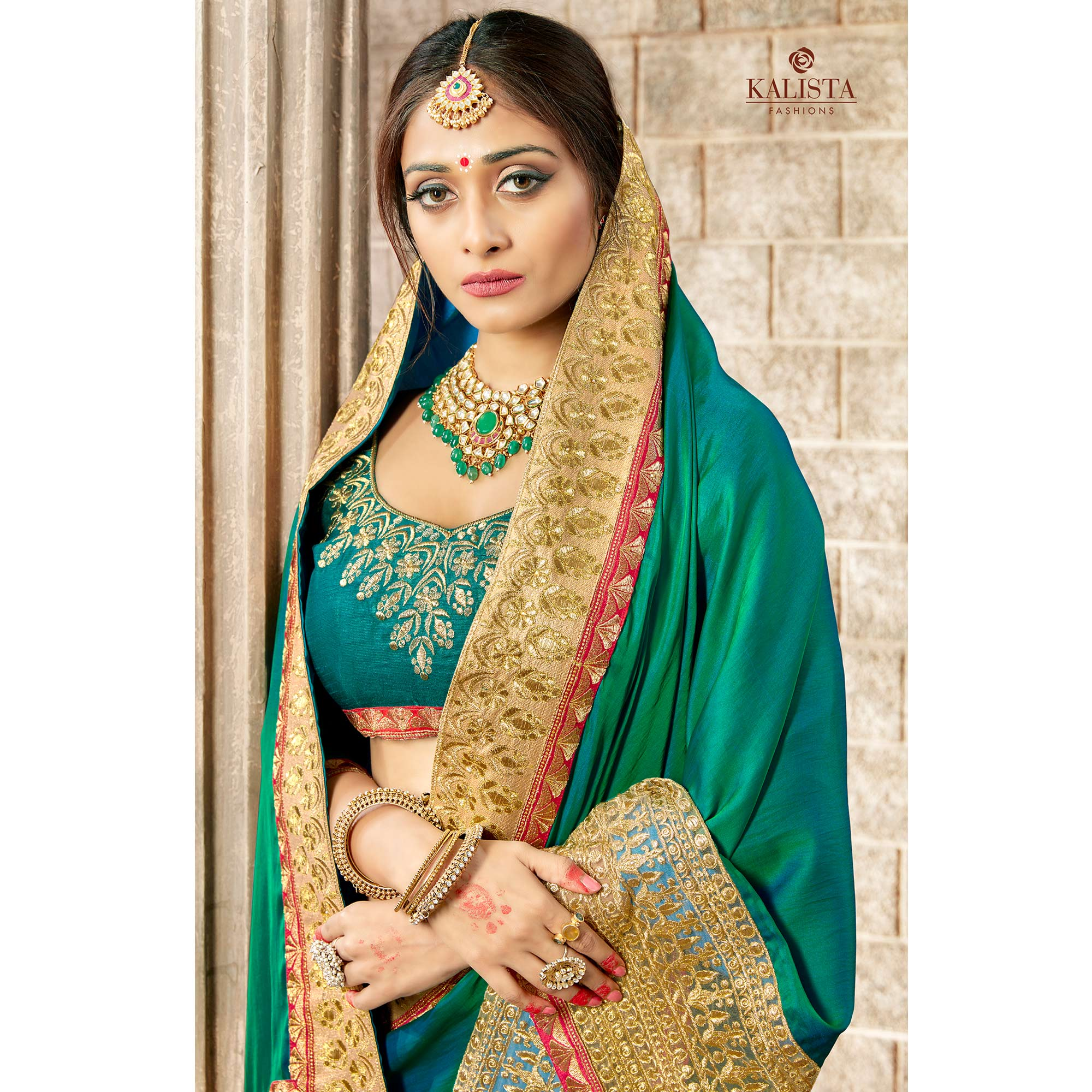 Stunning Turquoise Green Colored Partywear Embroidered Rangoli Silk Saree