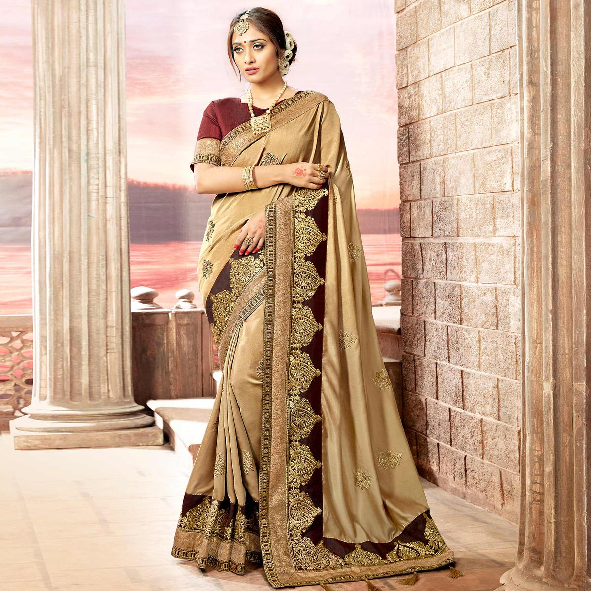Entrancing Beige Colored Partywear Embroidered Rangoli Silk Saree