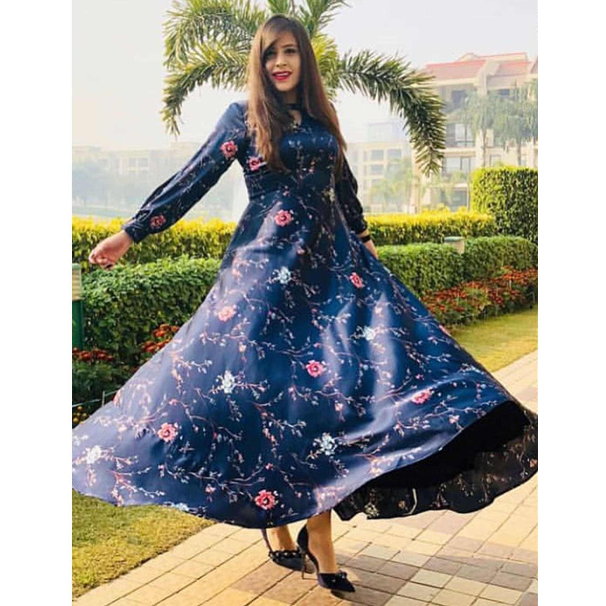 Ravishing Navy Blue Colored Partywear Printed Crepe Long Kurti