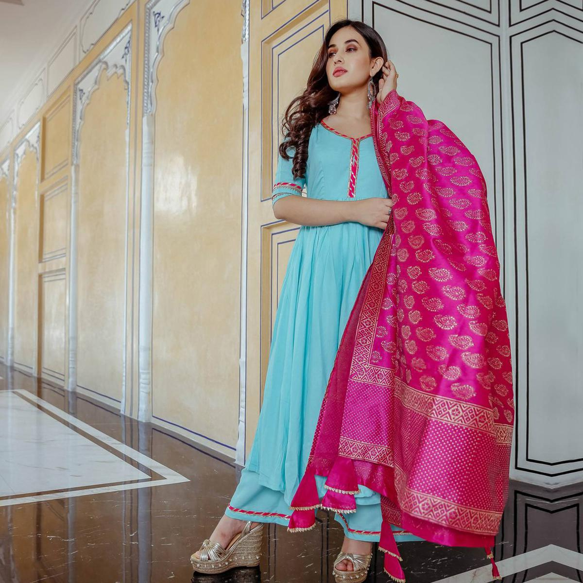 Dazzling Sky Blue Colored Partywear Muslin Cotton Palazzo Suit