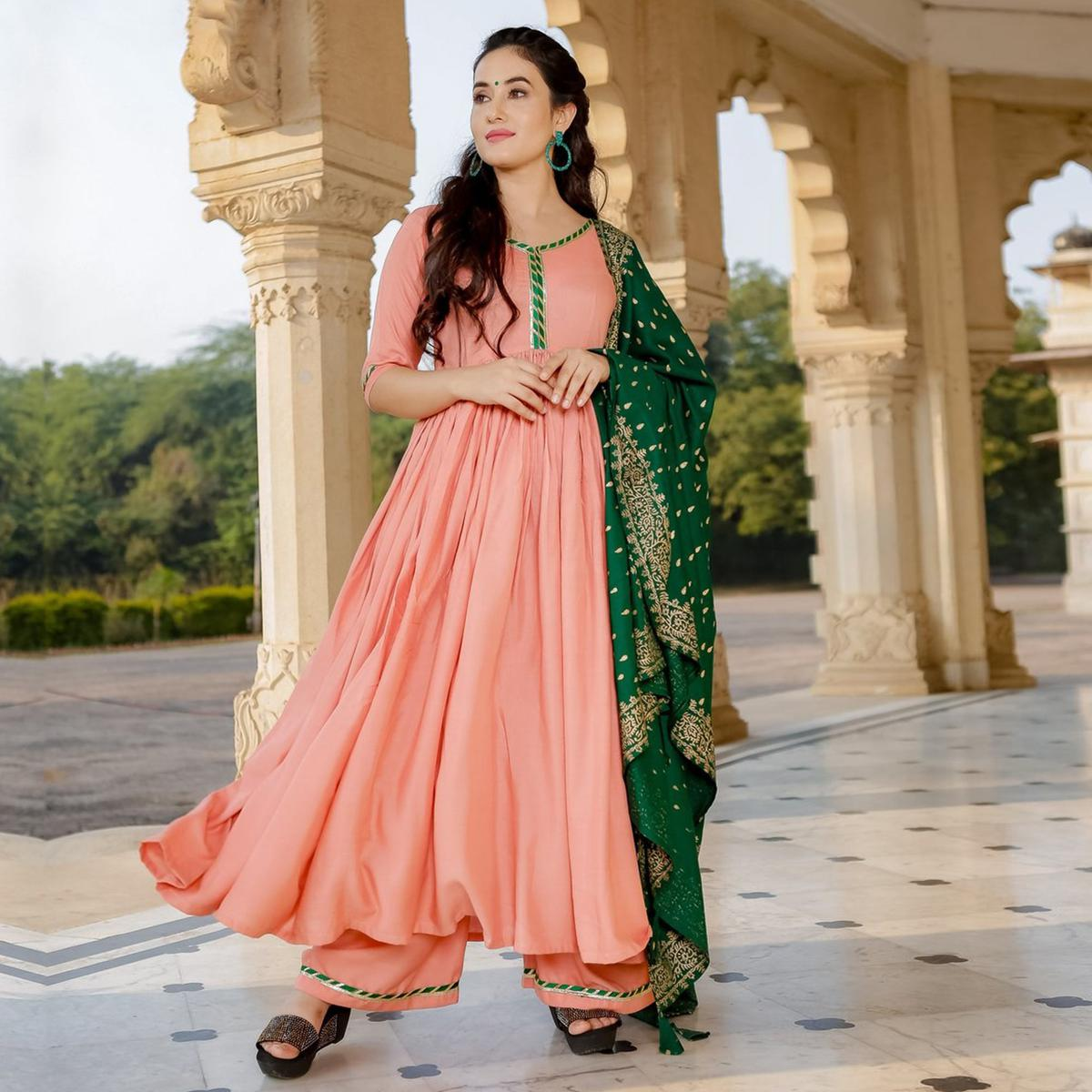 Surpassing Peach Colored Partywear Muslin Cotton Palazzo Suit