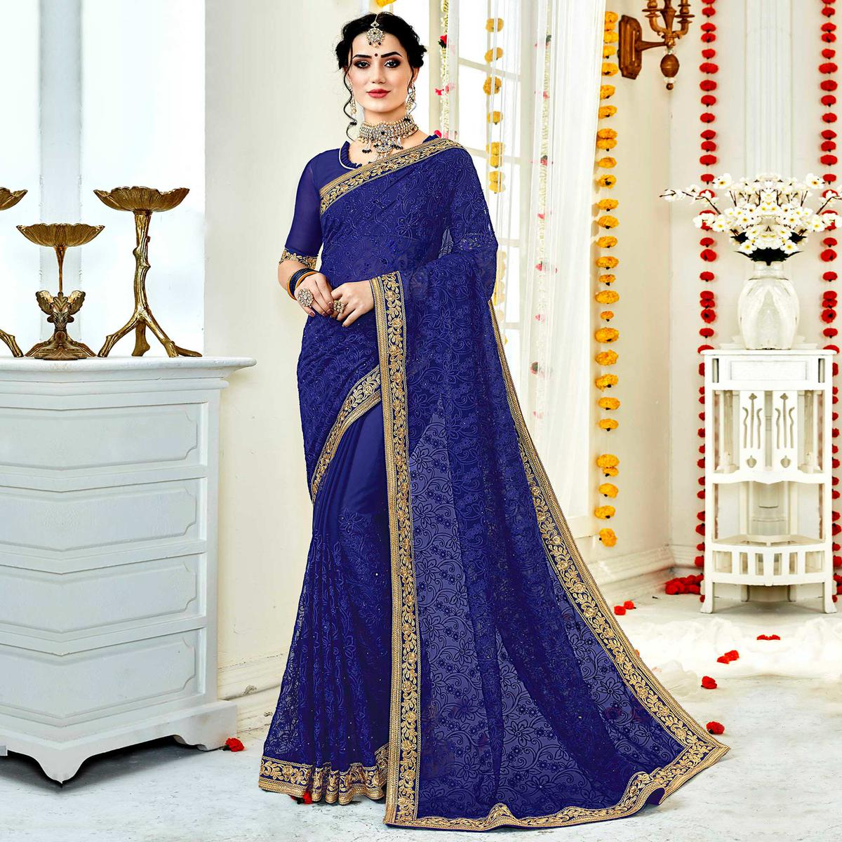 Engrossing Blue Colored Partywear Embroidered Georgette Saree