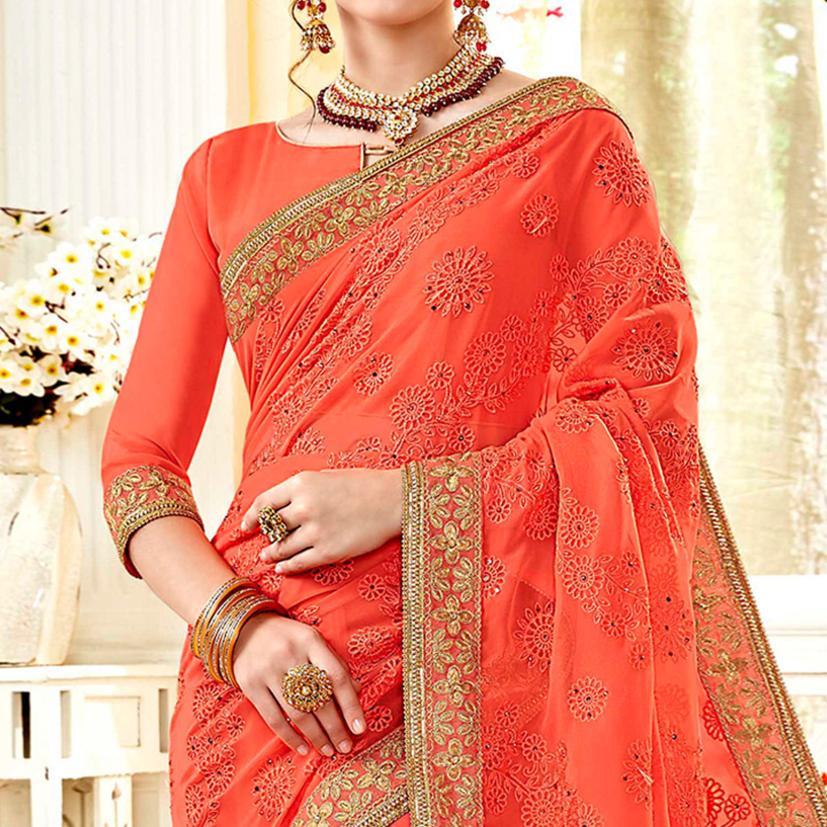Captivating Peach Colored Partywear Embroidered Georgette Saree