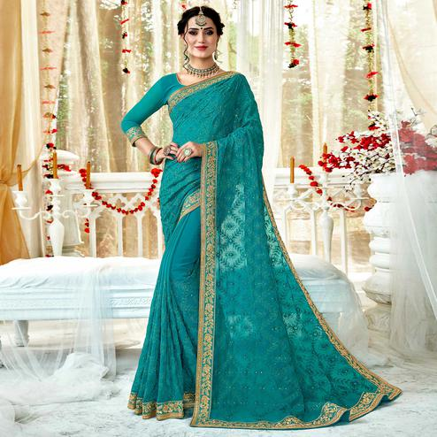 Amazing Sky Blue Colored Partywear Embroidered Georgette Saree