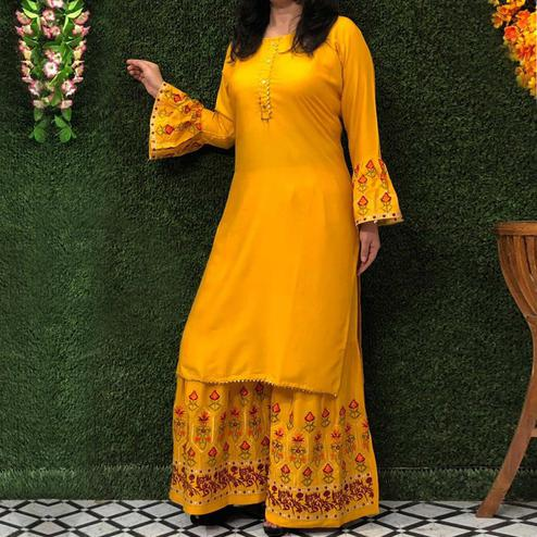 Lovely Yellow Colored Partywear Embroidered Rayon Palazzo Suit