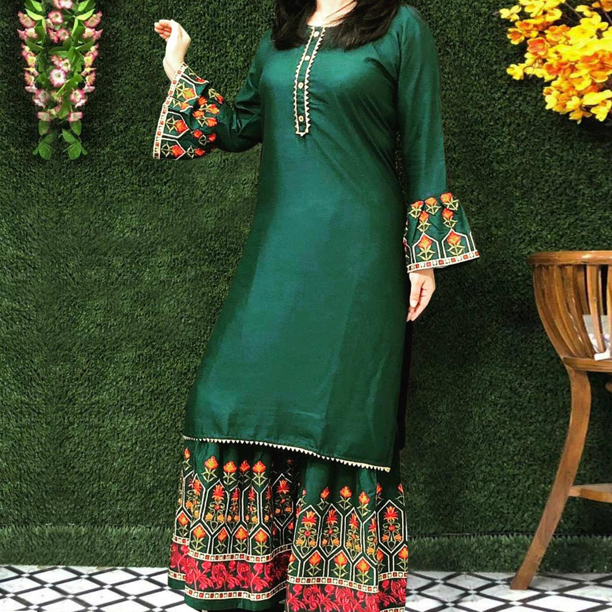 Impressive Dark Green Colored Partywear Embroidered Rayon Palazzo Suit
