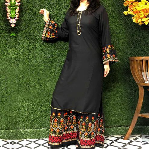 Mesmerising Black Colored Partywear Embroidered Rayon Palazzo Suit