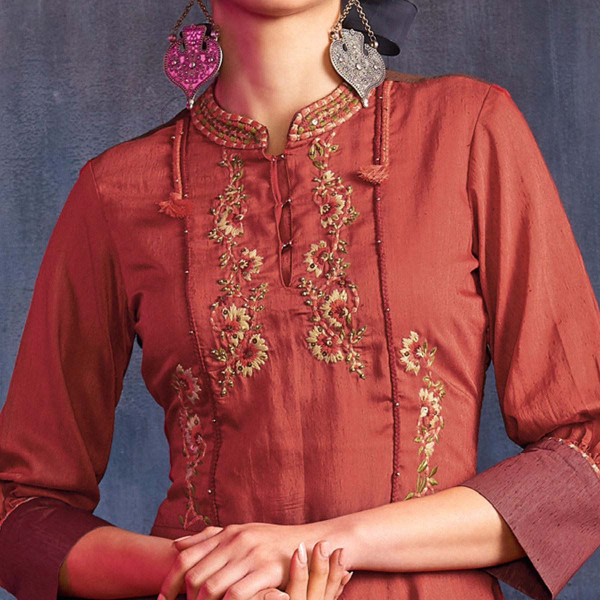 Capricious Maroon Colored Partywear Embroidered Viscose Gown
