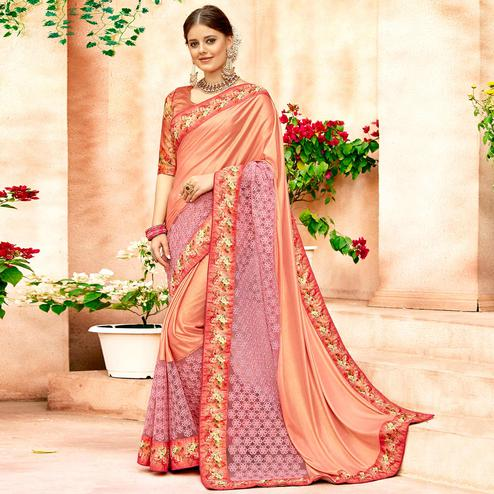 Amazing Peach Colored Partywear Printed Lycra & Net Saree